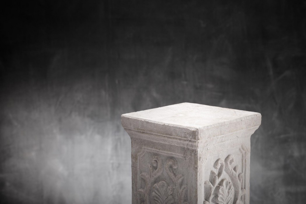 A Plaster column with nothing on top.