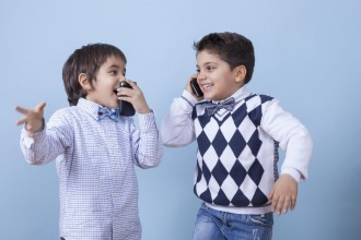 Two little businessmen are closing a deal over the phone.