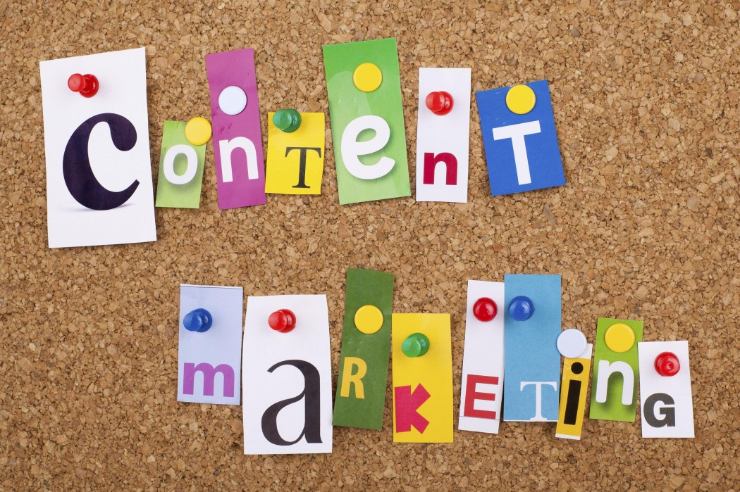 Content Marketing single letters pinned on cork noticeboard