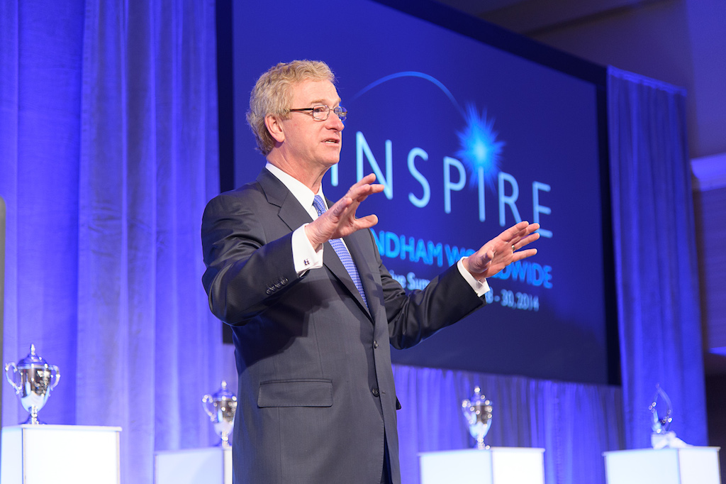 Wyndham Worldwide CEO Stephen Holmes speaks at a corporate event.