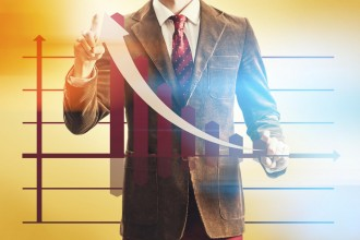 Sales success concept with business man pointing chart