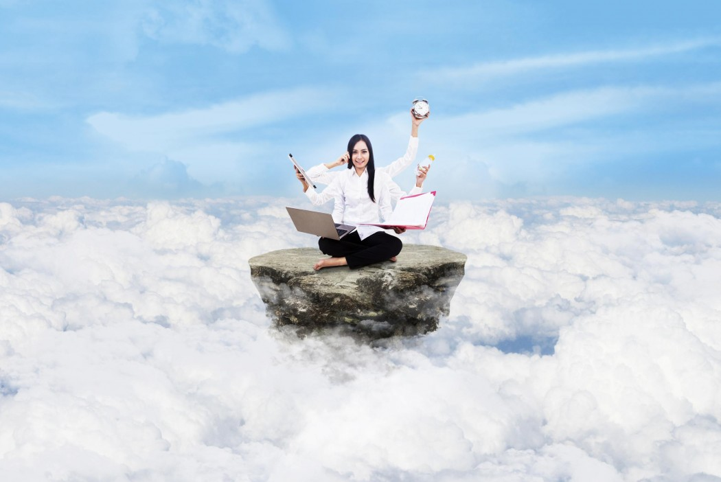 Young entrepreneur is doing multitasking above the clouds