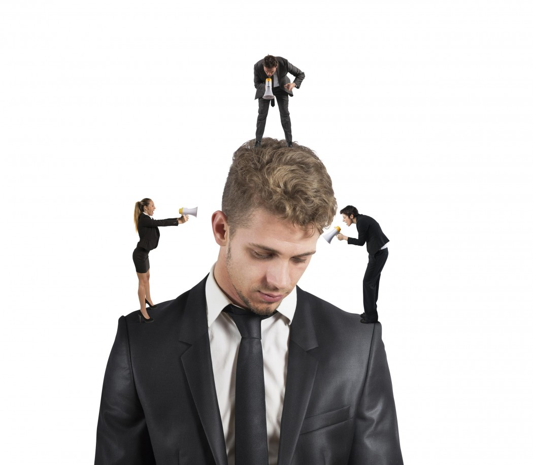 Concept of stressed man due to colleagues