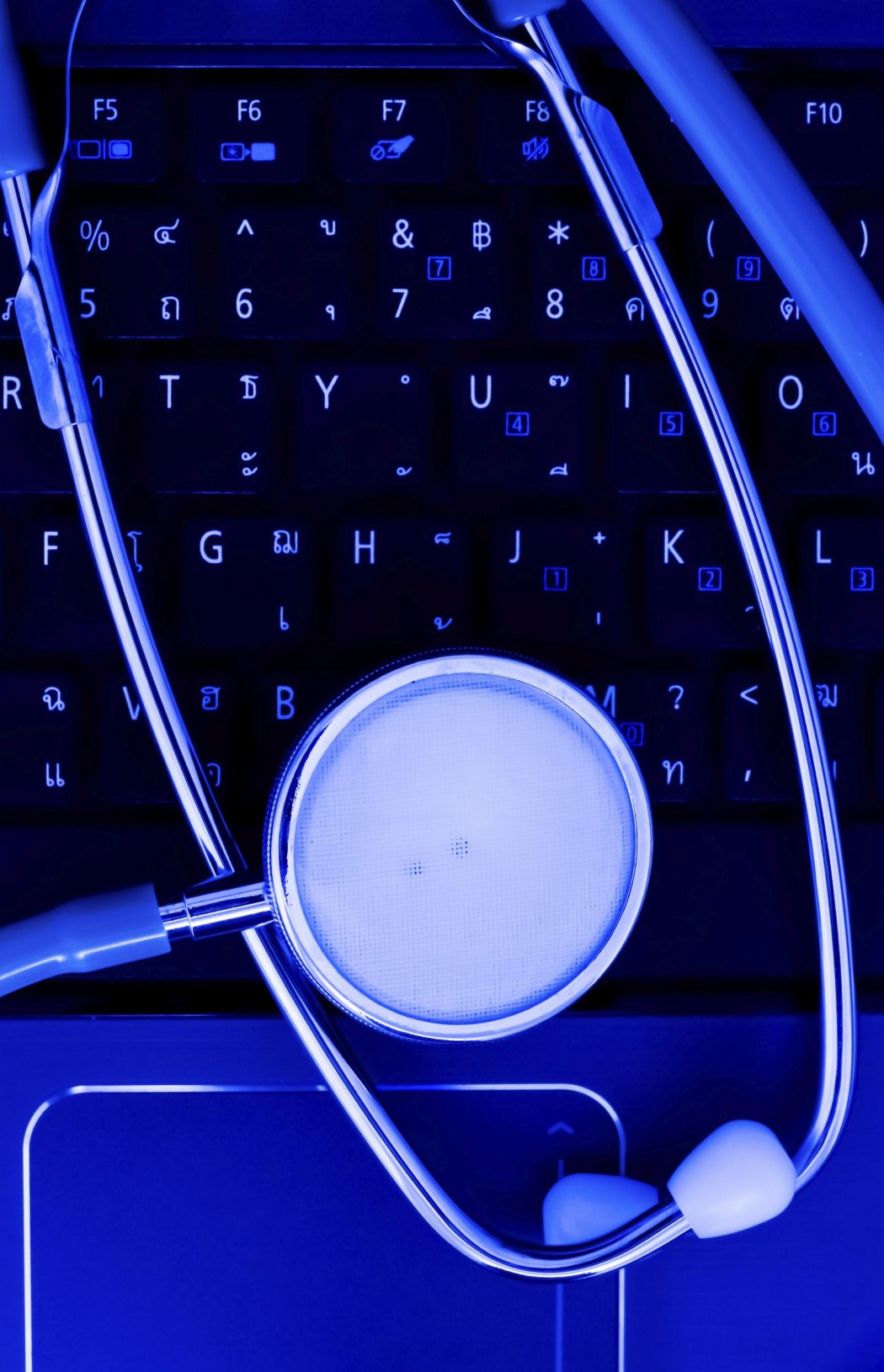 Medical stethoscope and a portable laptop. Medical Information and technology concept.