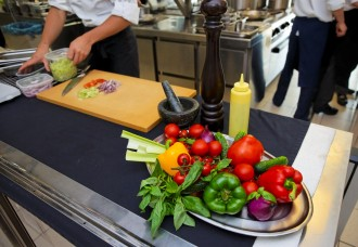 Work at the professional kitchen - fresh vegetables on table