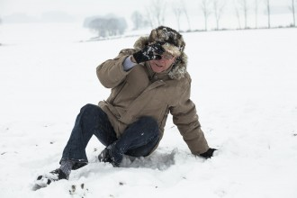 Senior man accident falling on snow in winter.