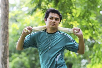 Asian man exercising in the park