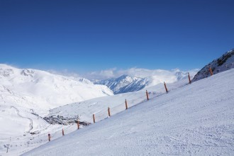 Ski piste for sking in mountains with panoramic landcape
