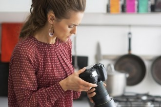 Young woman practicing in food photography