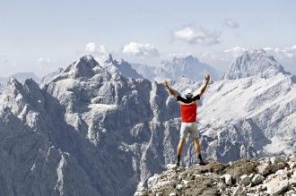 Man standing on a cliff felling invincible