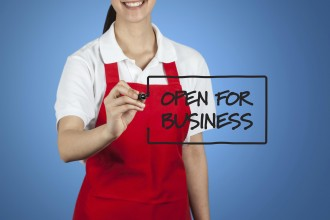 Female Small Business Owner Writing Open for Business