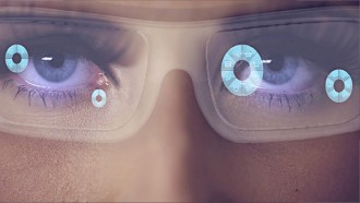 girl using Conceptual image of wearable technology. Glasses with information in their lenses.