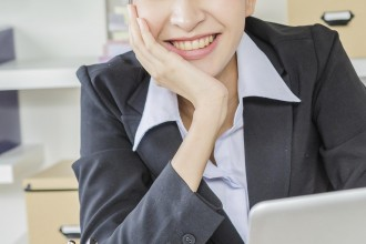 Business women happy with laptop in office