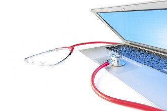 Open silver laptop with blue screen isolated on white background. Red stethoscope on computer. Online repair and virus detection. Medical diagnostic and help. Instrument for system checkup.