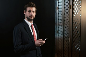 Portrait of entrepreneur with a smartphone in his hand