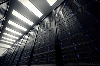Image presents a bottom view of a room equipped with data servers. Blue LED lights are flashing. Image can represent cloud computing, information storage, etc. or can be the perfect technology background.