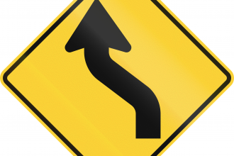 US road warning sign: Reverse curve