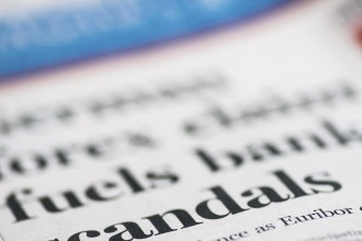 Scandals written newspaper, real newspaper, shallow dof.