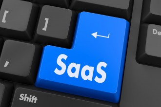 SAAS - Software as a Service - on Red Button on Black Computer Keyboard.