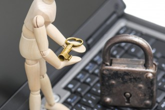 A wooden doll recalls with golden key security in computer