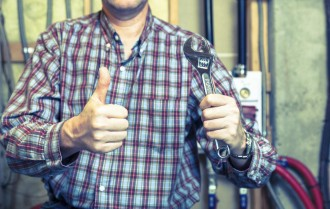Handyman showing thumbs up after finishing a project
