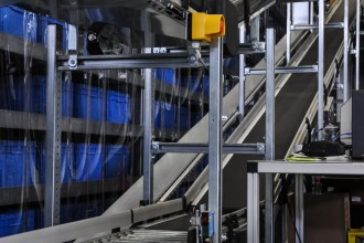 Close up shot of two roller conveyors in an automated warehouse.Close up shot of two roller conveyors in an automated warehouse.