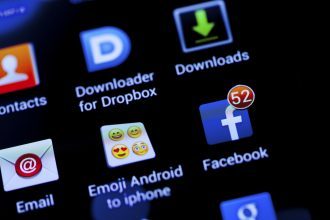 New York City, USA - October 22, 2013: Close-up view of 52 facebook notifications with some other phone app on a smart phone. Facebook is a social networking service, owned and operated by Facebook, Inc.