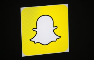 "CIRCA AUGUST 2014 - BERLIN: the logo of the brand ""Snapchat"", Berlin."