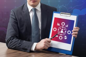 businessman in office holding clipboard with analytics concept