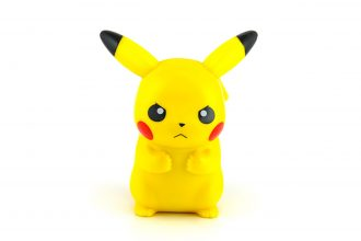 BANGKOK, THAILAND - June 28, 2014 : Pickachu toy character from Pokemon anime. There are toy sold as part of McDonald Happy Meal toy.