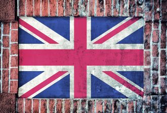 Flag of United Kingdom on the old brick window