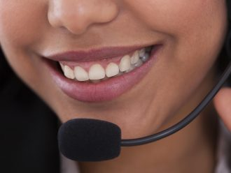 Close-up Of Happy Young Female Customer Representative