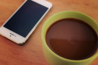 Cup of coffee on a wooden table - Instagram filter