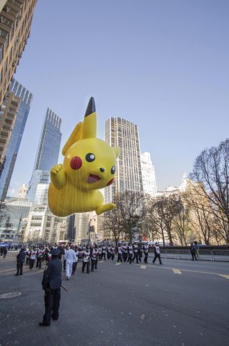 New York City, New York, United States - November 28, 2013 : Pokemon's Pikachu flying through W 59th ST during the Macy's 87th Annual Thanksgiving Day Parade.