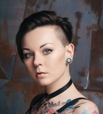Portrait of young tattooed women with Beautiful blue eyes
