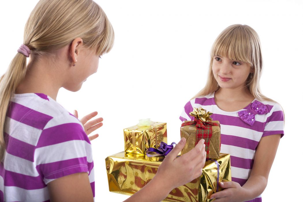 Girl Giving  Gifts to Another Girl