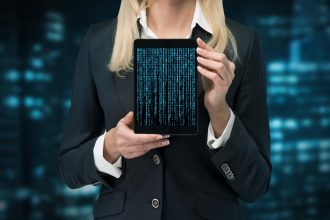 businesswoman holding touch pad with cyberspace