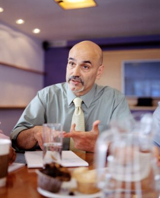 Gesturing boss in a meeting.shallow depth of field and slight movement.Business concept