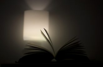Reading in the light of the lamp.