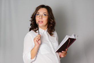 Pregnant business woman comes up with an idea, and writes in a notebook