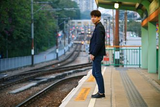 Asia man waiting train at outdoor